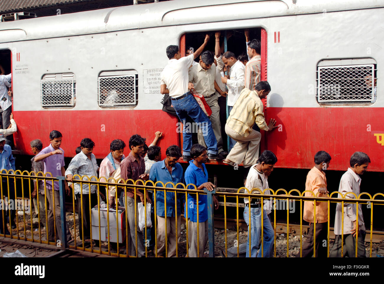 Train transportation during peak hours ; Bombay now Mumbai ; Maharashtra ; India - Stock Image