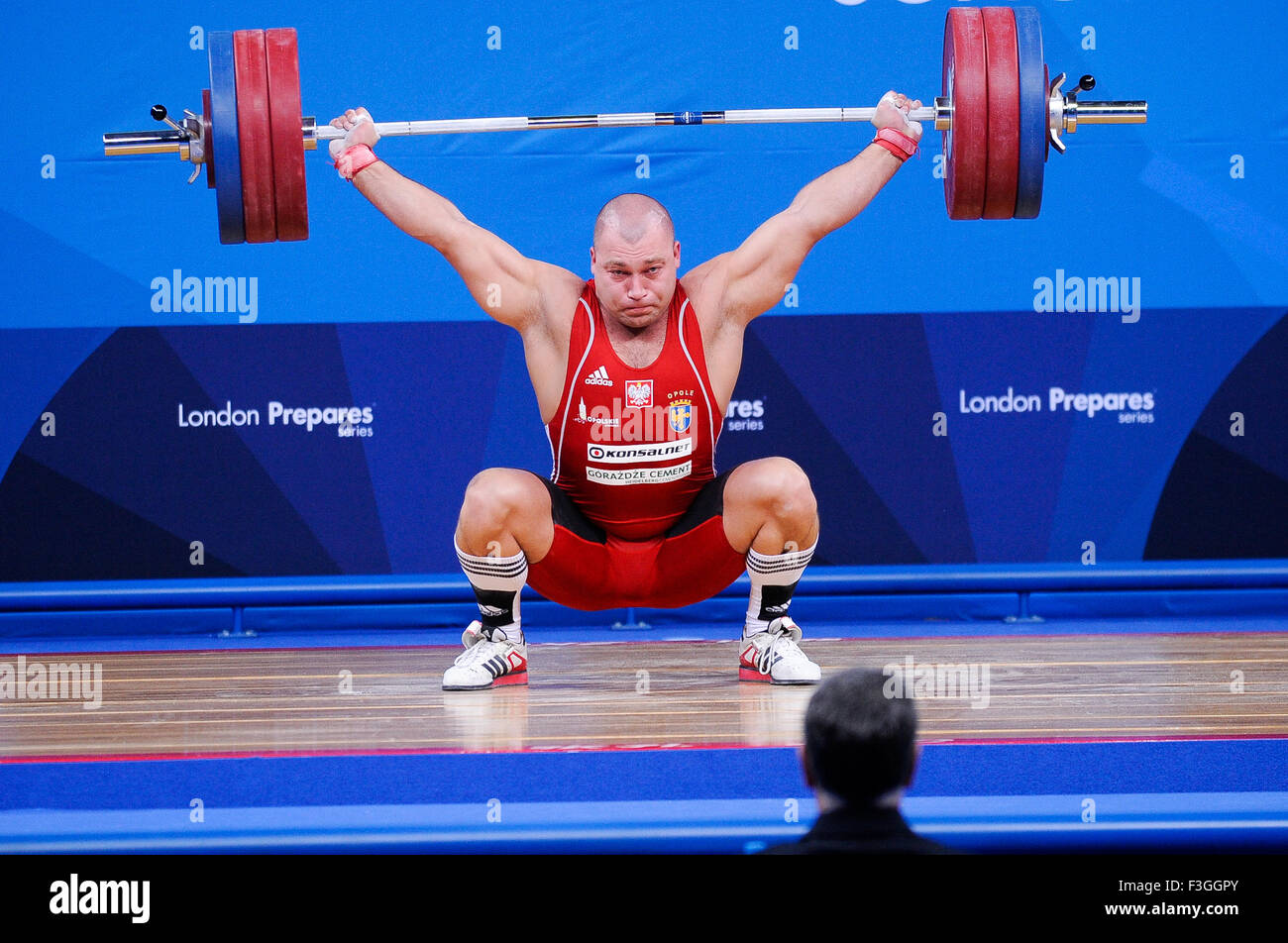 Bartlomiej BONK (POL) in the snatch, The London Prepares Weightlifting Olympic Test Event, ExCel Arena, London, - Stock Image