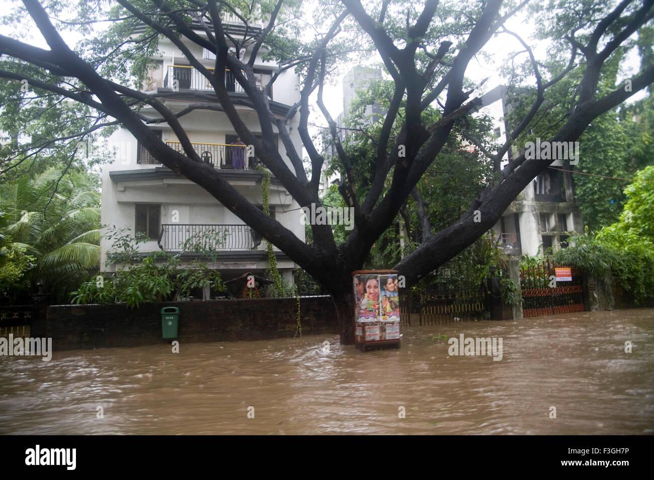 Monsoon ; heavy waterlogged on suburb road ; Mumbai Bombay ; Maharashtra ; India 5th july2006 - Stock Image