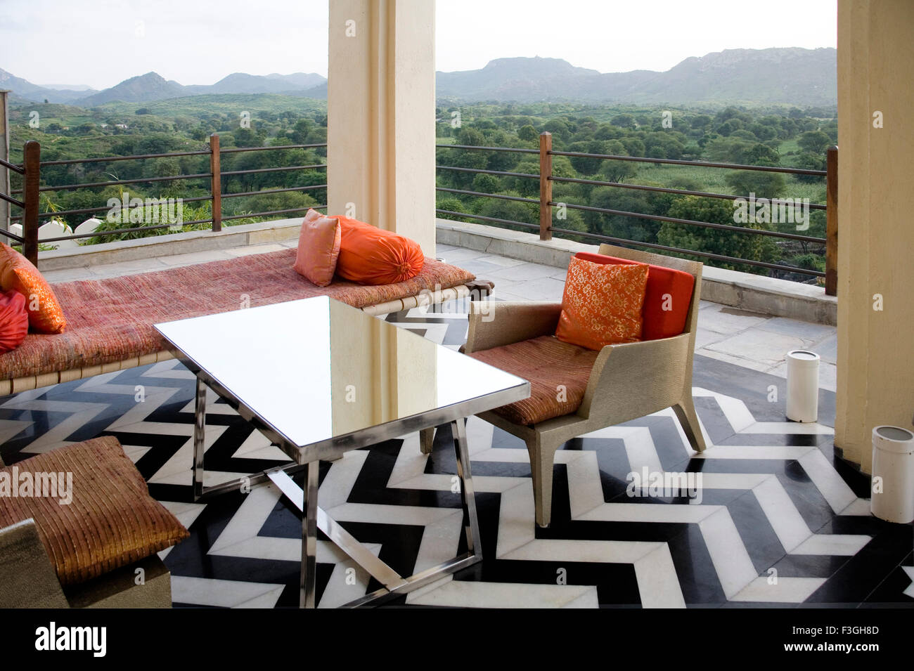 marble flooring chairs bed balcony restful luxury royal setup rich palace Devigadh turned hotel Village Dilwara - Stock Image