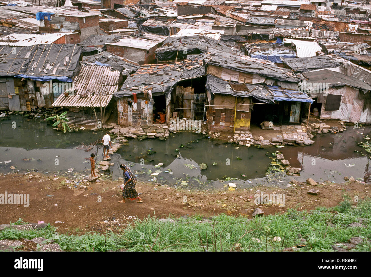 Unhygienic conditions in a slum in Mumbai Bombay ; Maharashtra ; India - Stock Image