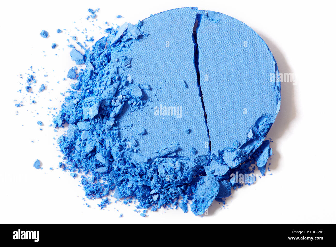 Blue eye shadow, crushed cosmetic on white - Stock Image