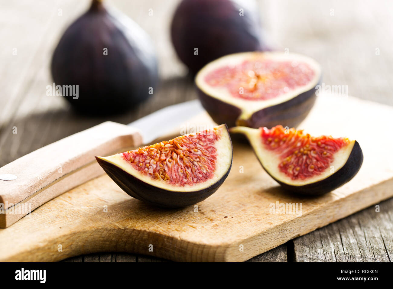 sliced fresh figs on cutting board Stock Photo