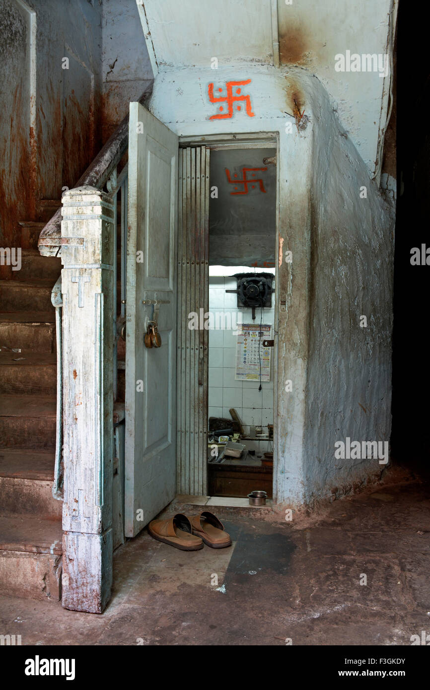 A space under a staircase is creatively converted in a jewellery repair shop ; Mumbai Bombay ; Maharashtra ; India - Stock Image