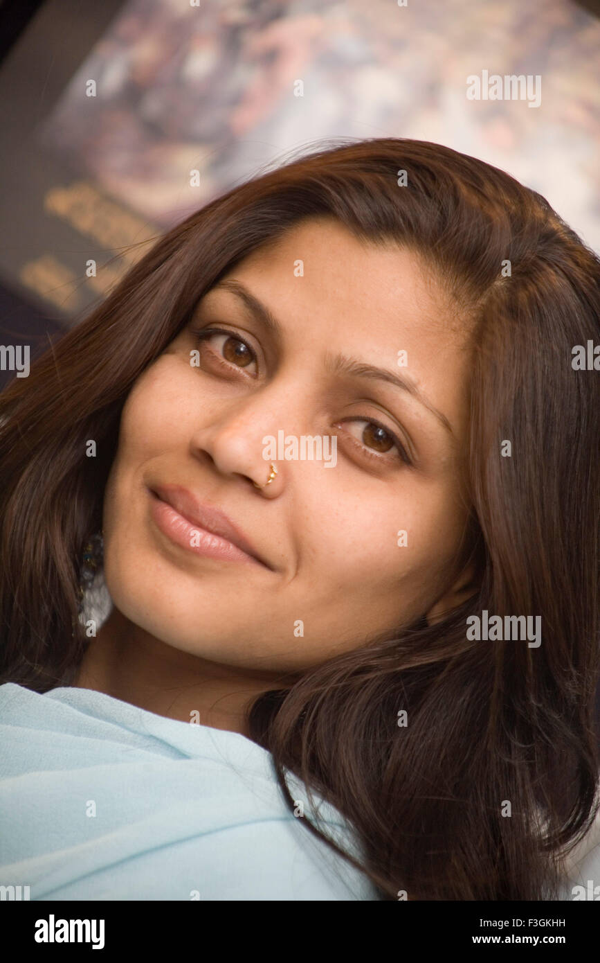 South Asian Indian Young girl named Pinky smiling Garhwal region ; Uttaranchal ; India MR#542 - Stock Image