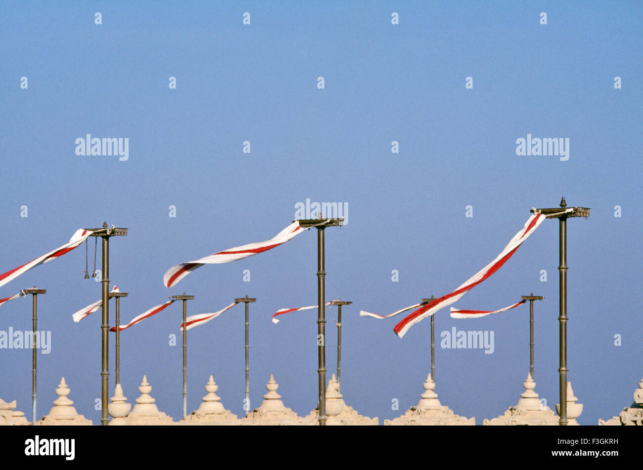 Red and white flags fluttering above Jain temples in Palitana ; Gujarat ; India - Stock Image