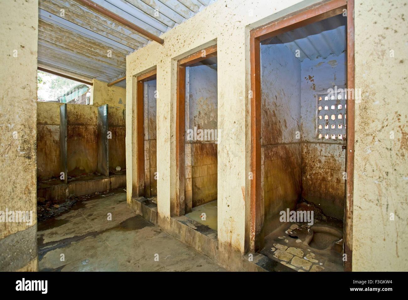 Public toilets for gents in a slum in unhygienic condition ; slum Khotwadi ; Santacruz ; Bombay now Mumbai ; Maharashtra Stock Photo