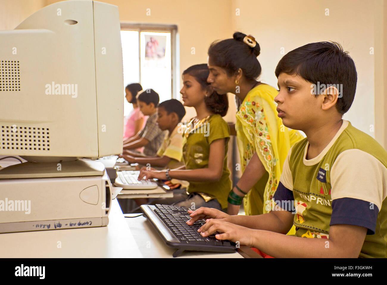 Computer classes for slum children run by NGO Triratna Prerna Mandal ; Santacruz ; Bombay now Mumbai ; Maharashtra - Stock Image