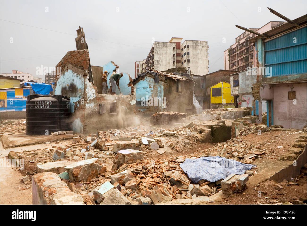 A house being demolished in Dharavi slums ; Bombay now Mumbai ; Maharashtra ; India - Stock Image