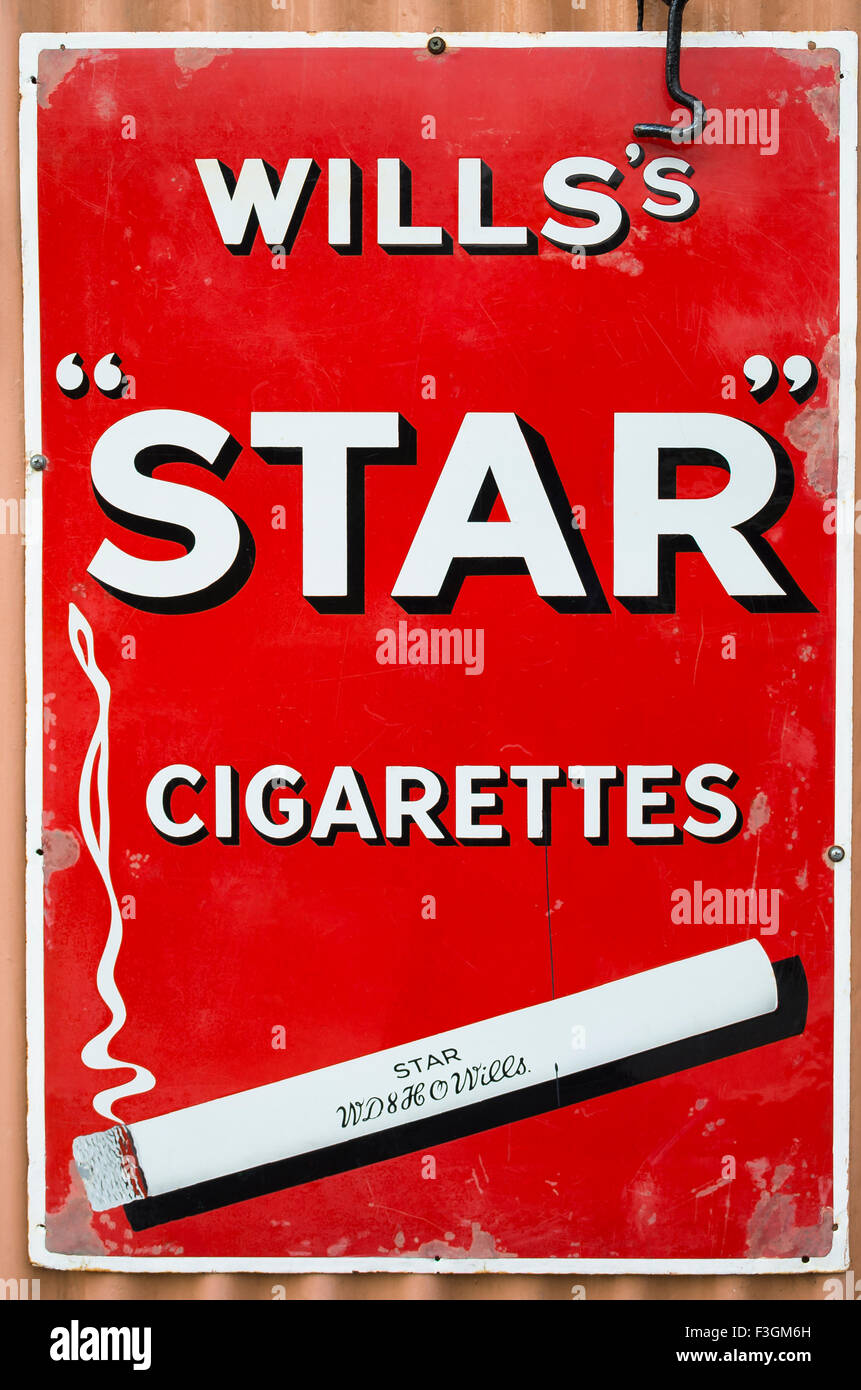 Old metal advert for Wills's STAR cigarettes in UK - Stock Image
