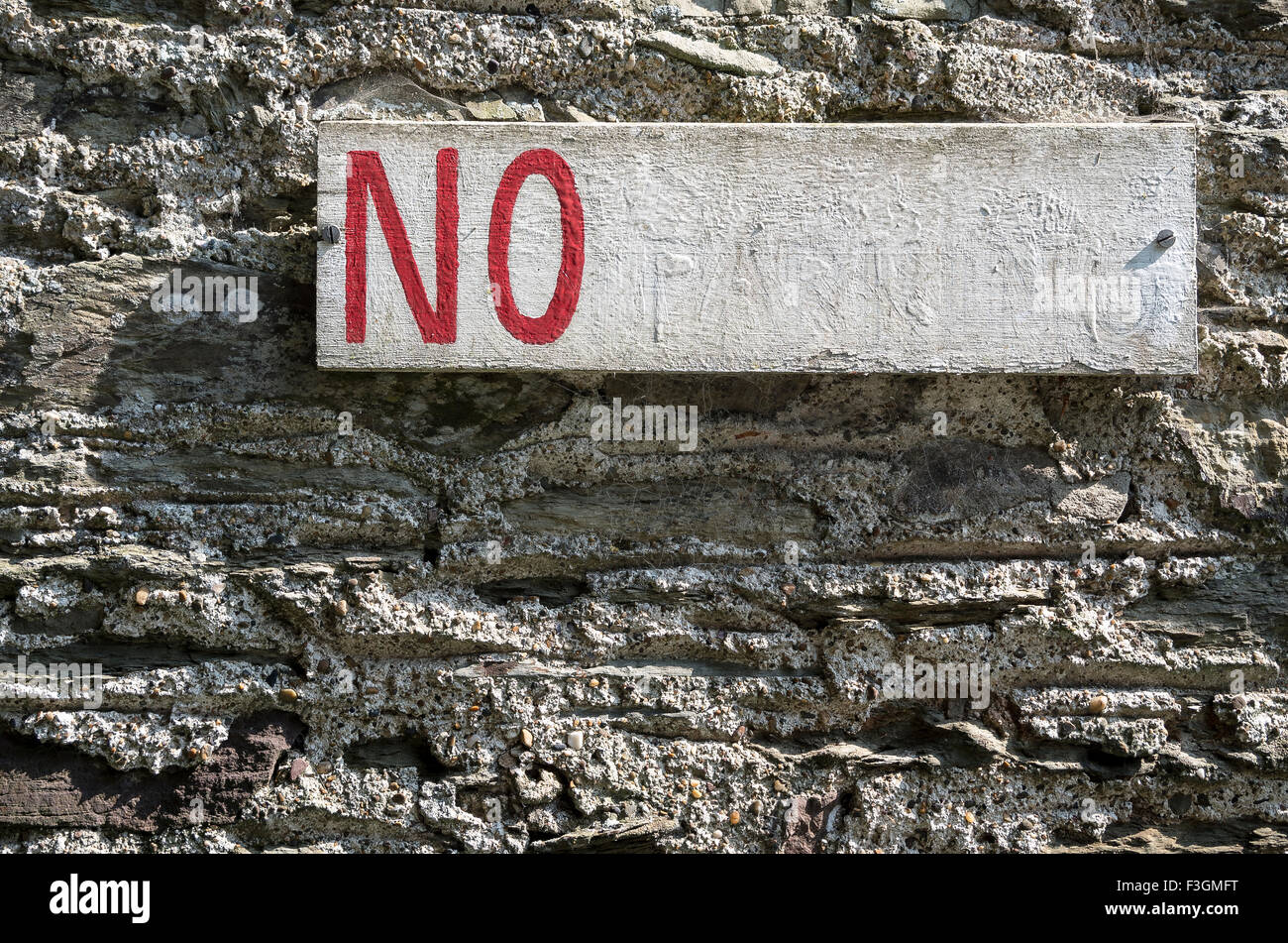 Incomplete warning sign on wall announcing NO - Stock Image