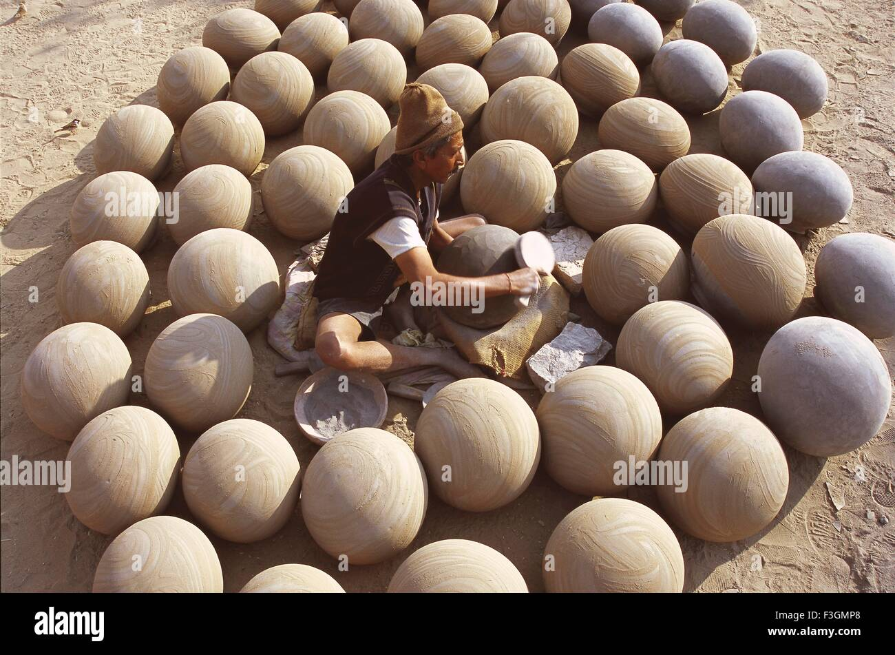 Pottery ; potter giving shape to clay pots ; Bikaner ; Rajasthan ; India - Stock Image