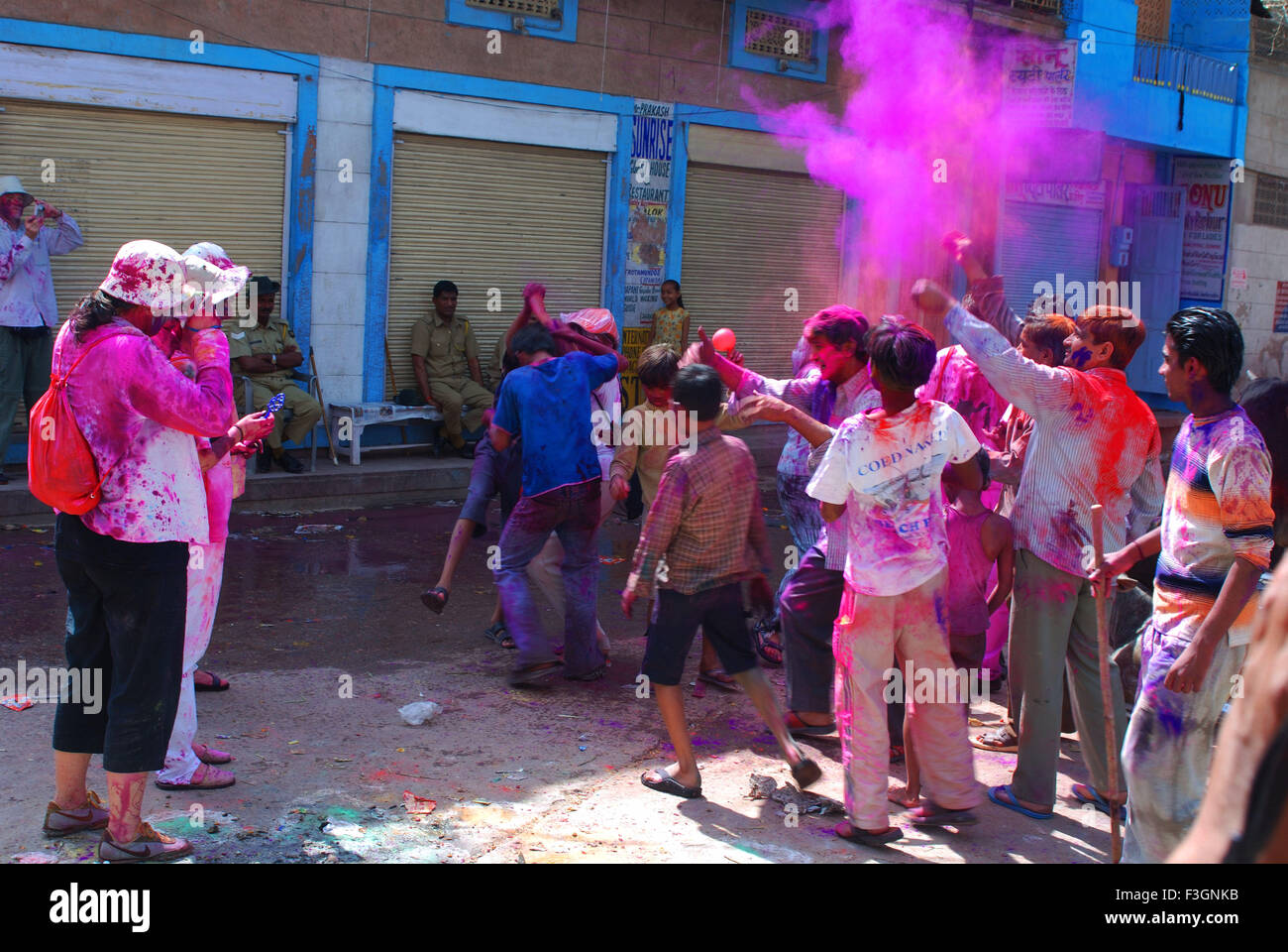 Foreigners with local people enjoying holi festival ; Jodhpur ; Rajasthan ; India - Stock Image
