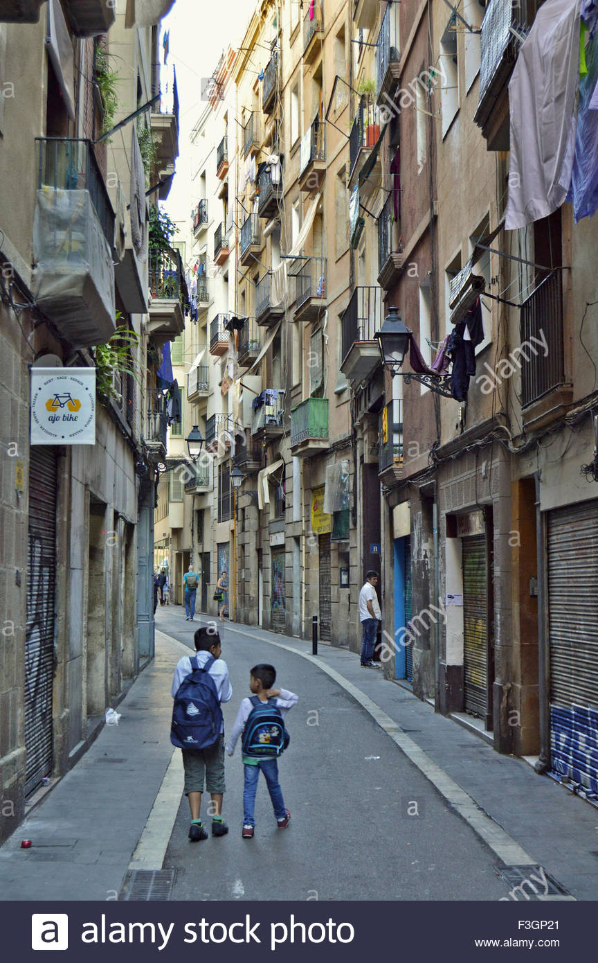 Street of El Raval neighborhood which has a very diverse immigrant ...