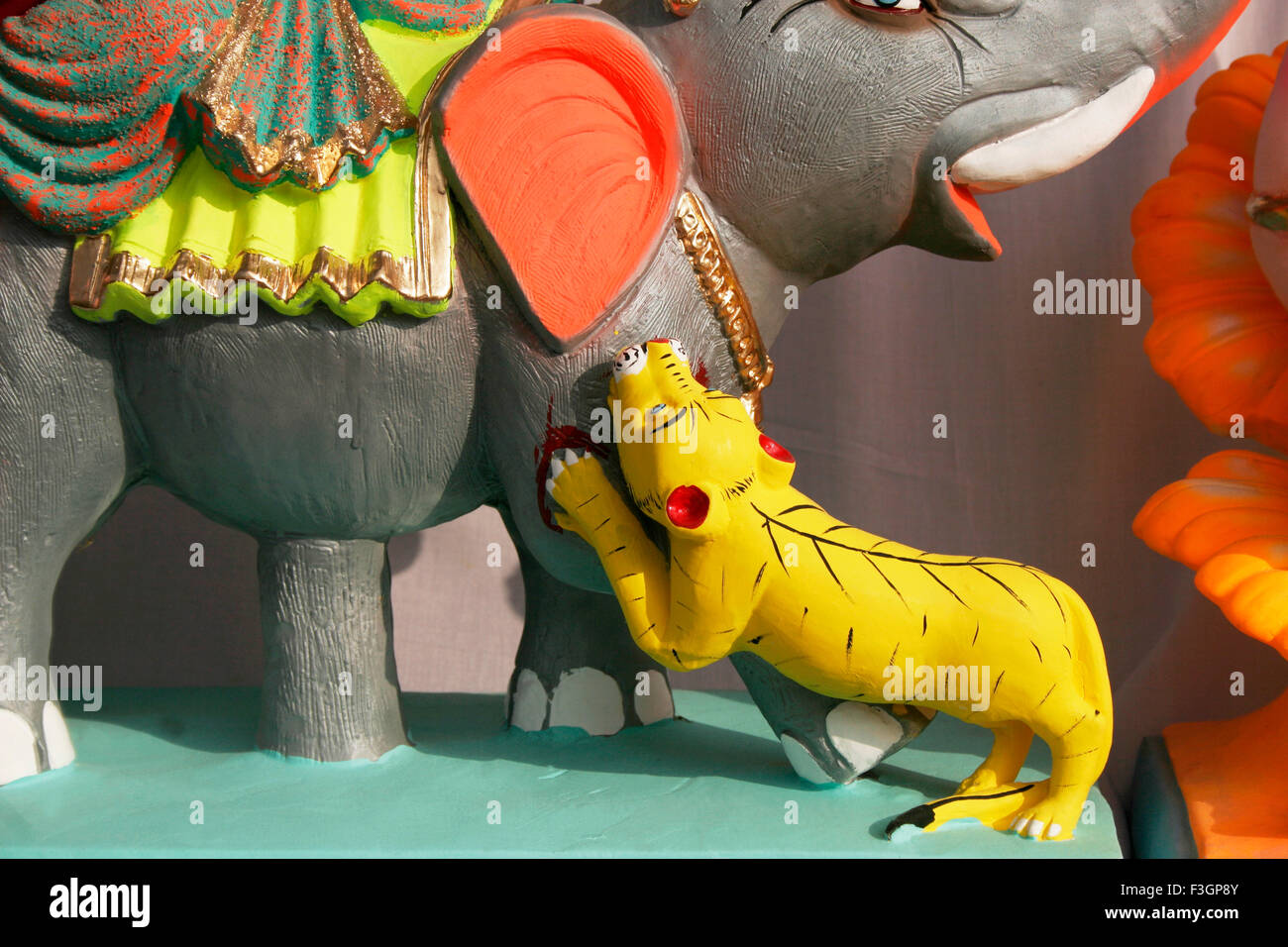 Depiction of a tiger pouncing on an elephant made with clay ; Pune ; Maharashtra ; India - Stock Image