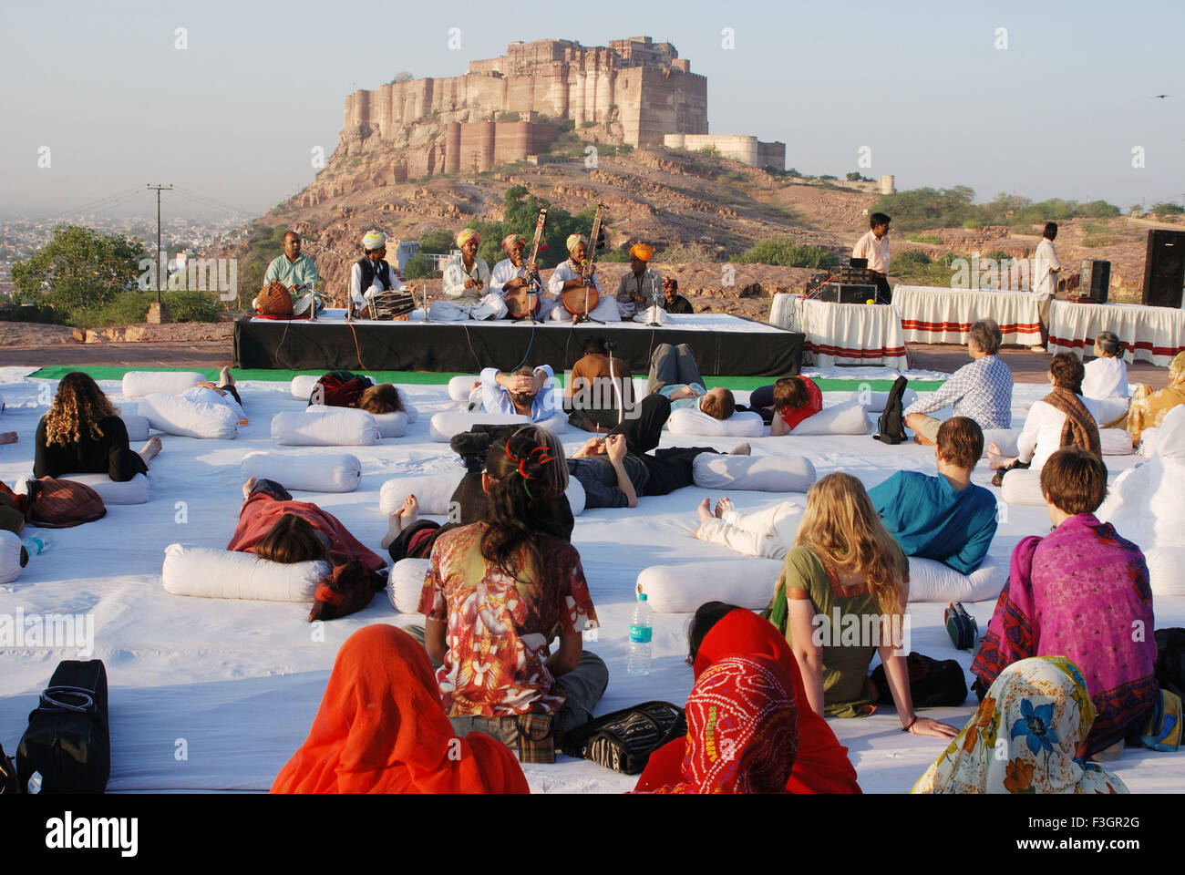 Tourists enjoying folk music during Marwar festival ; Jodhpur ; Rajasthan ; India - Stock Image