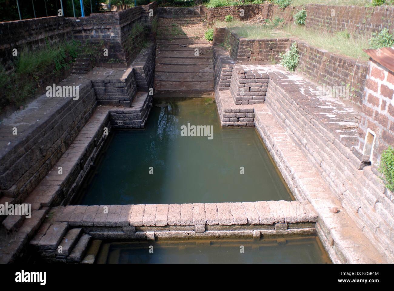 Old well water storing system in Ganpatipule ; District Ratnagiri ; Maharashtra ; India - Stock Image