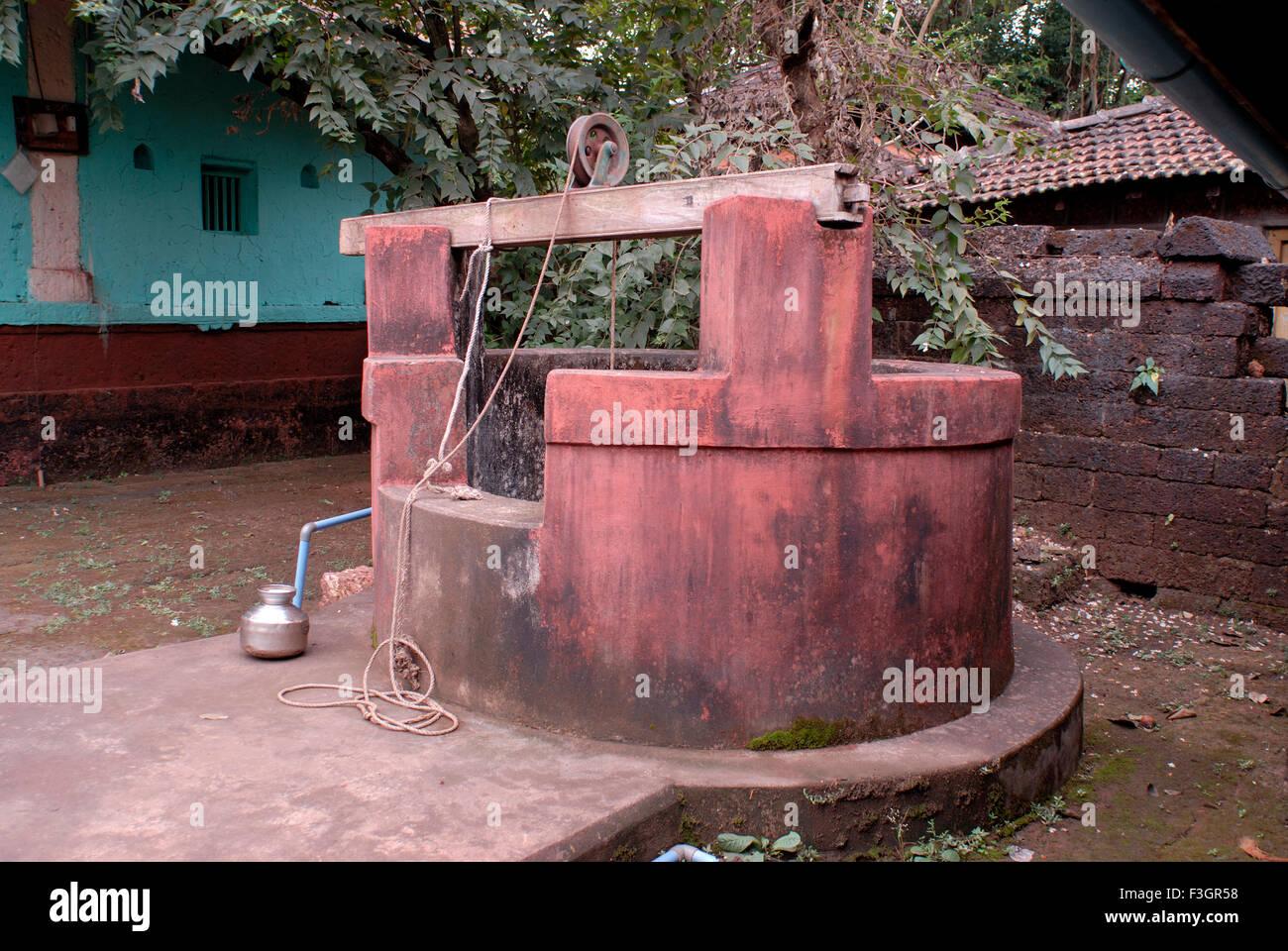 A old well at the temple of shree Devi Bhagvati ; Sansthan ; Village Kotkamte ; district Sindhudurga ; Maharashtra - Stock Image