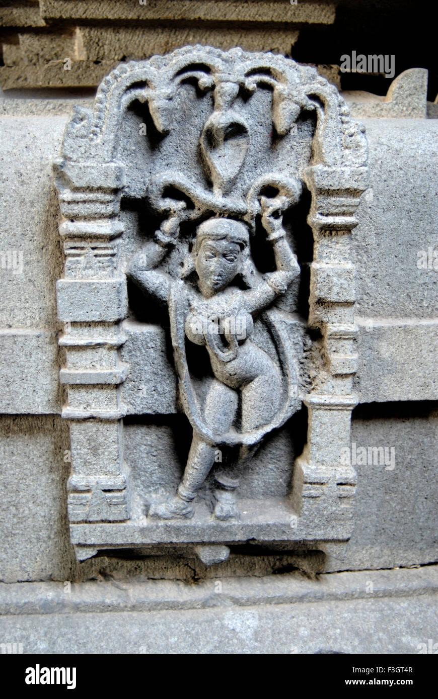 Decorative lady figure with snake cobra panels at Bhuleshvar temple on small hill Purander Pune Maharashtra - Stock Image