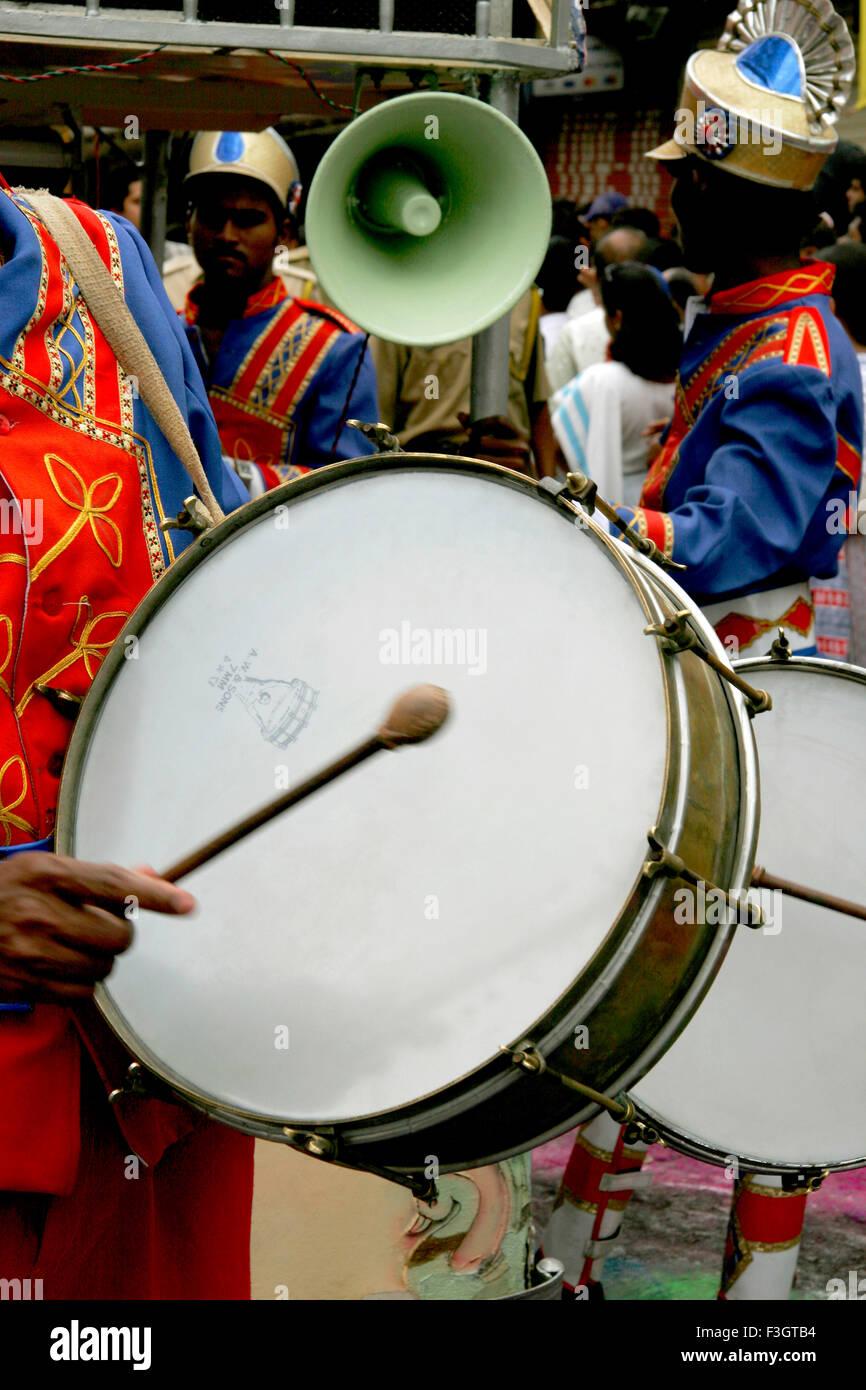 Musical instrument drum played immersion festival lord Ganesh ganpati Pune Maharashtra - Stock Image
