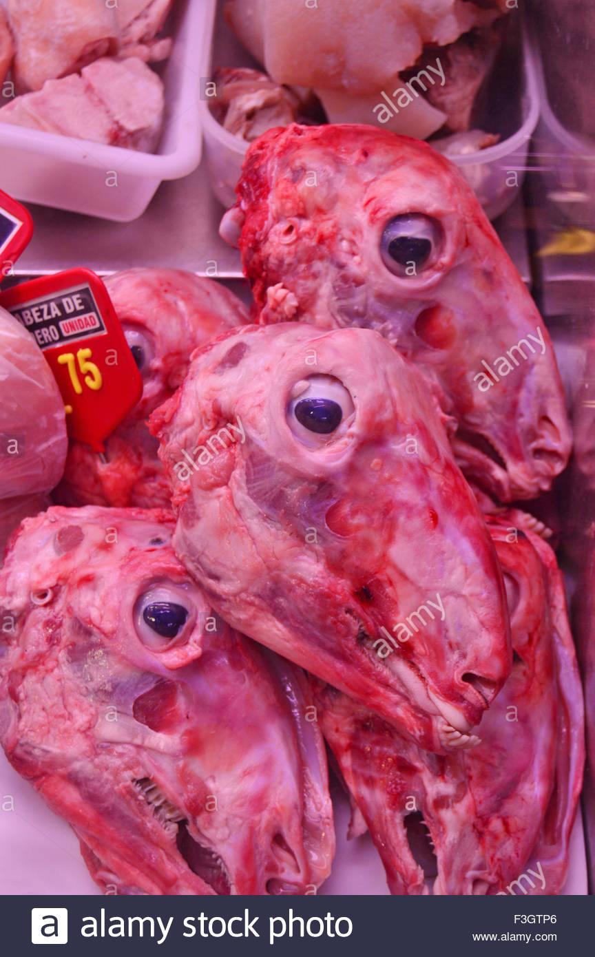 Skinned sheep heads displayed at La Boqueria market in Ciutat Vella Barcelona Spain Europe - Stock Image