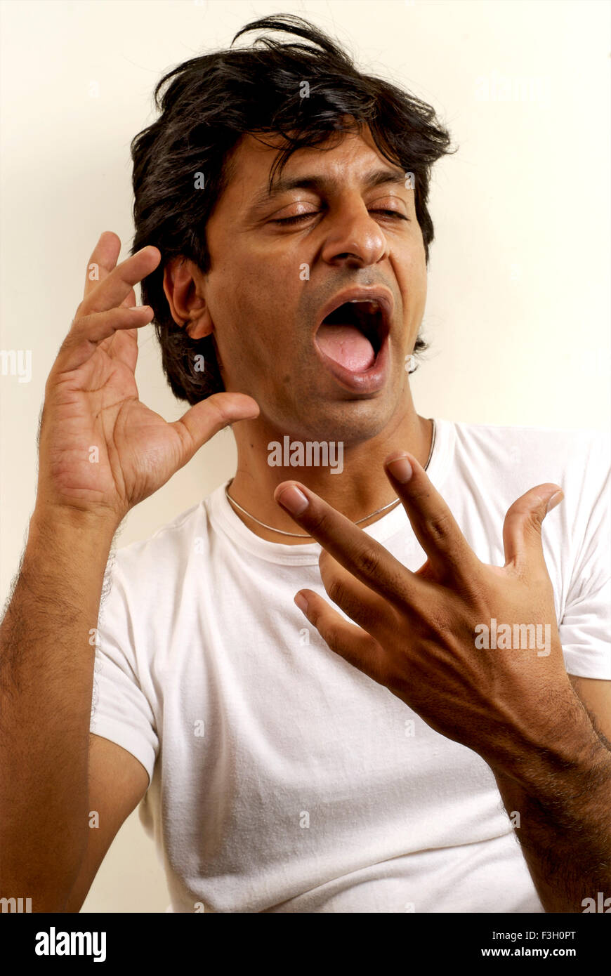 South Asian Indian man Alok Ulfat expressing Confusion with his hands MR#711 - Stock Image