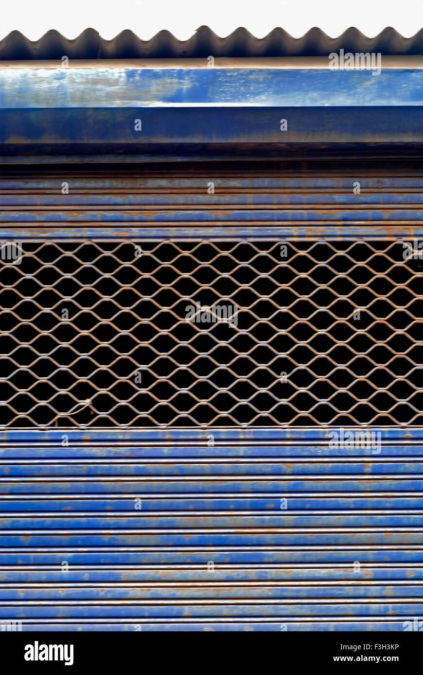 Corrugated metal sheet shutter with open grill ; Rajkot ; Gujarat ; India - Stock Image