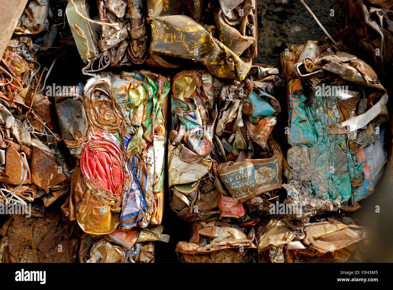 Crushed cans piled up in a scrap yard at Rajkot ; Gujarat ; India - Stock Image