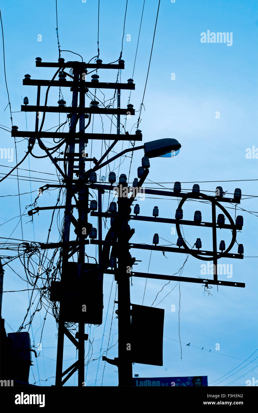 Chaos of electric wires suspended on poles at Rajkot ; Gujarat ; India - Stock Image