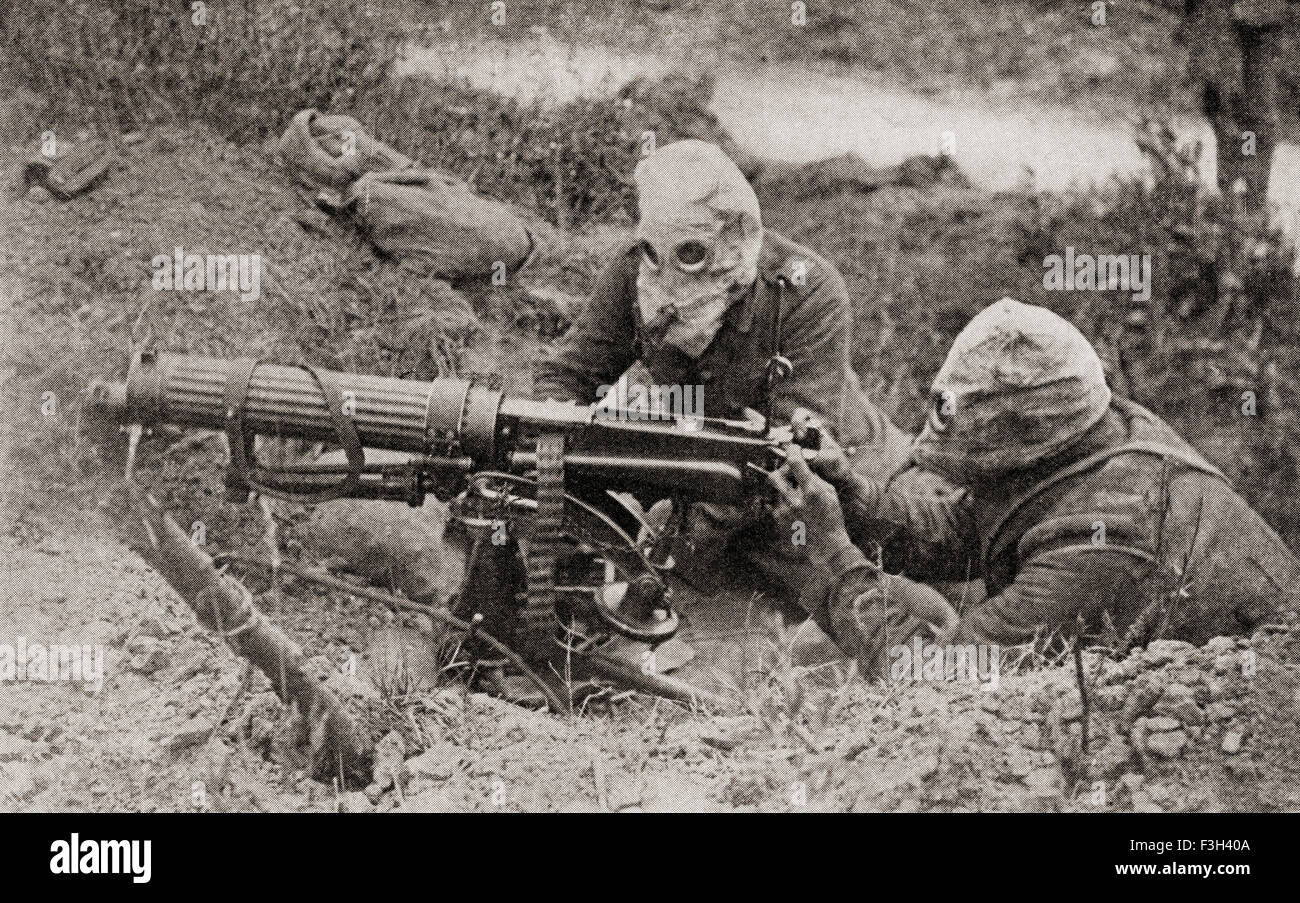 Machine gunners wearing masks to protect them from gas attacks during WWI. - Stock Image