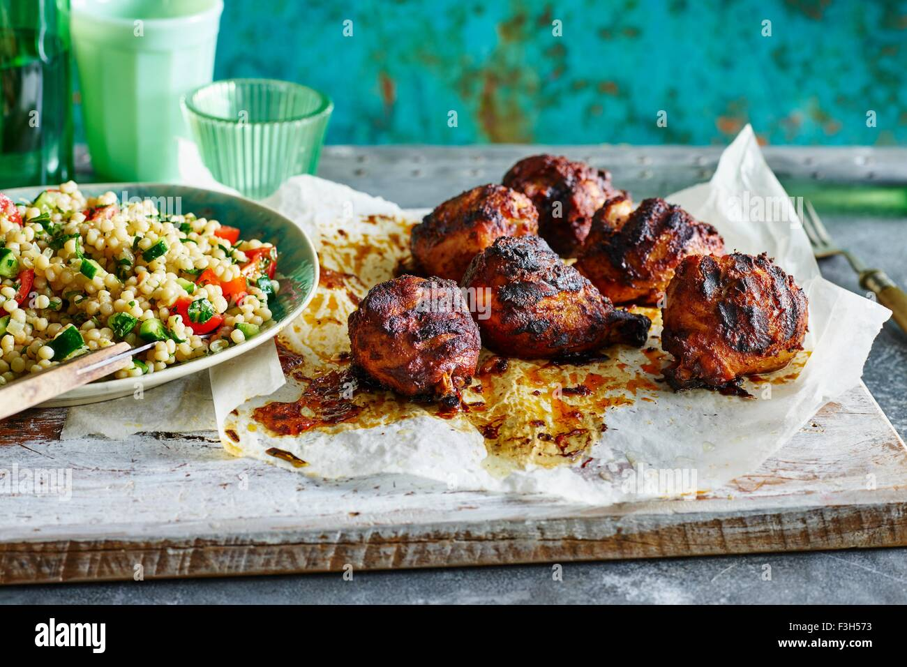 Smoked Paprika Chicken Legs, Pearl Couscous - Stock Image