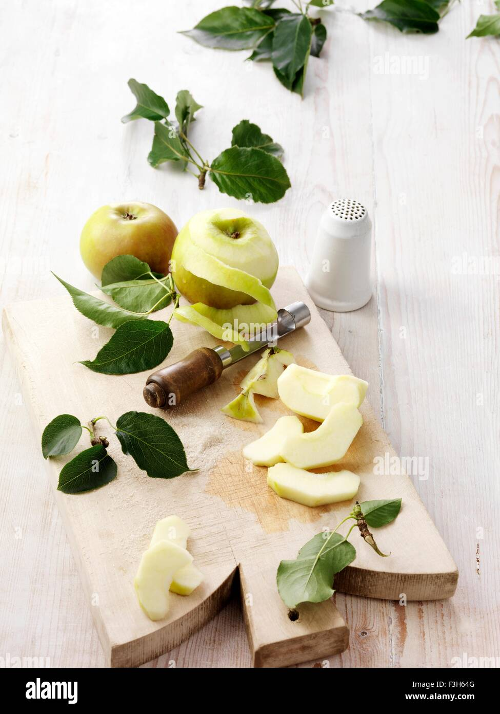 Ingredients for bramley apple crumble on whitewashed wooden table - Stock Image