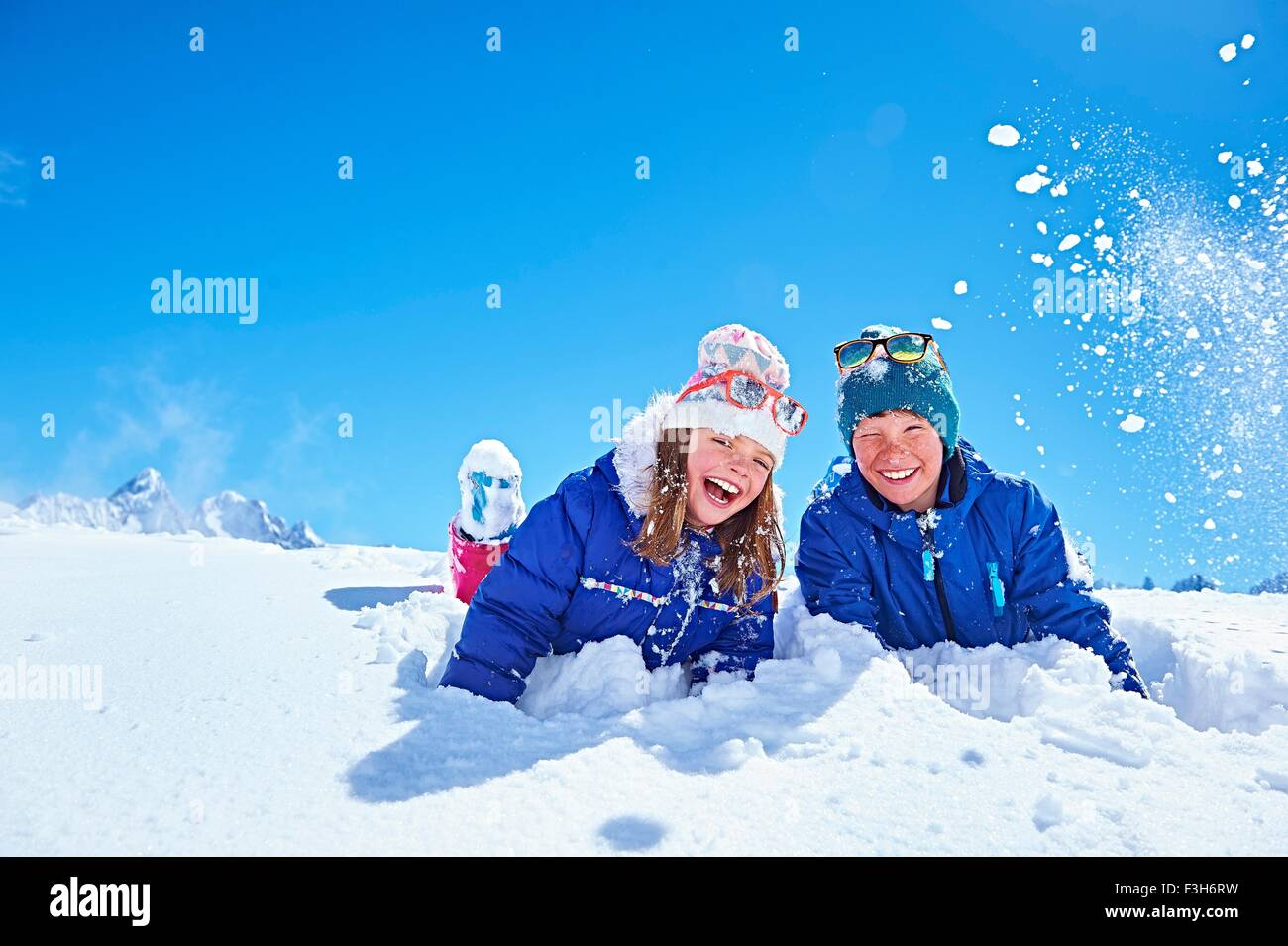 Siblings playing in snow, Chamonix, France - Stock Image