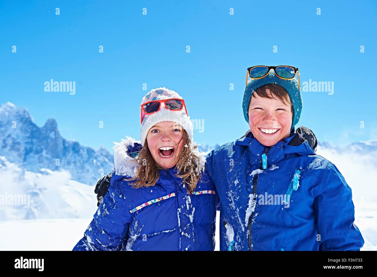 Siblings in winter clothing, Chamonix, France - Stock Image