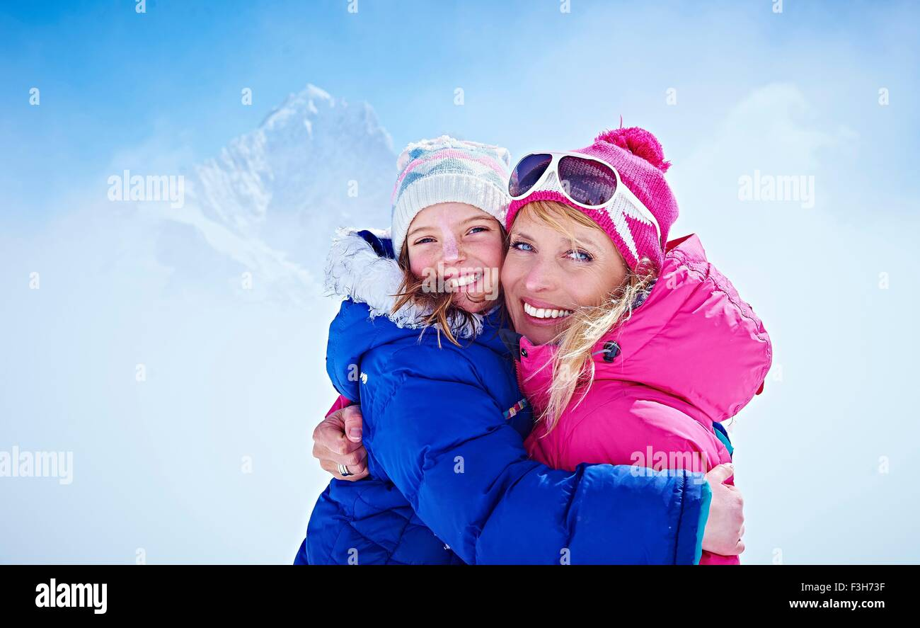 Mother and daughter hugging, Chamonix, France - Stock Image