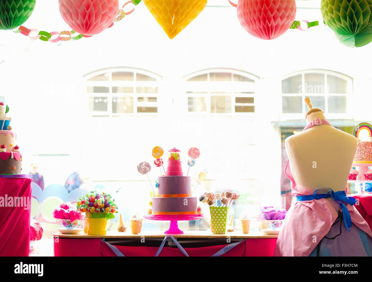 Still life of cake shop window display, taken from inside shop - Stock Image