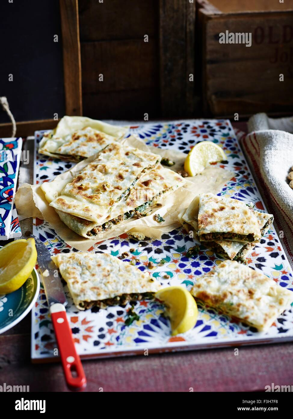 High angle view of lamb, feta and silverbeet gozleme served on ceramic tile - Stock Image