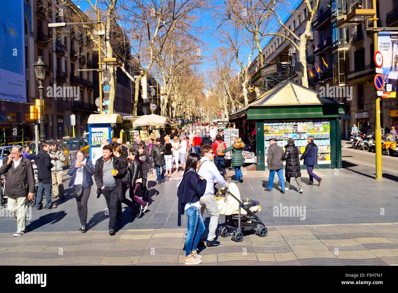 People walking along La Rambla. Barcelona, Catalonia, Spain. Stock Photo