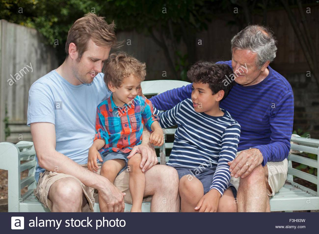 Three generation family in garden - Stock Image