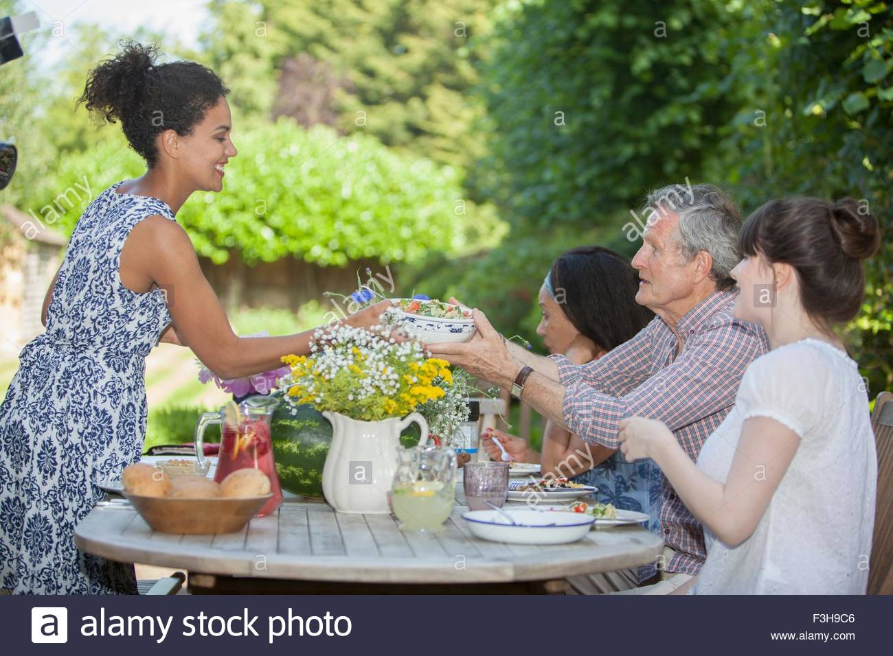 Family enjoying meal, outdoors - Stock Image