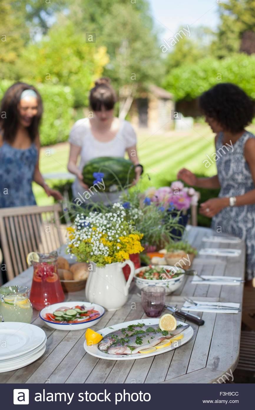 Family enjoying meal, outdoors - Stock Image
