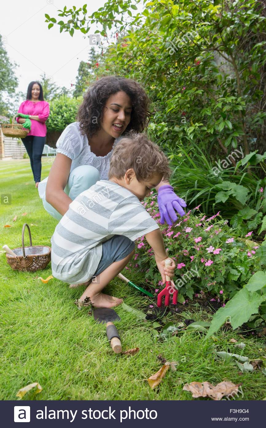Three generation family, gardening together Stock Photo