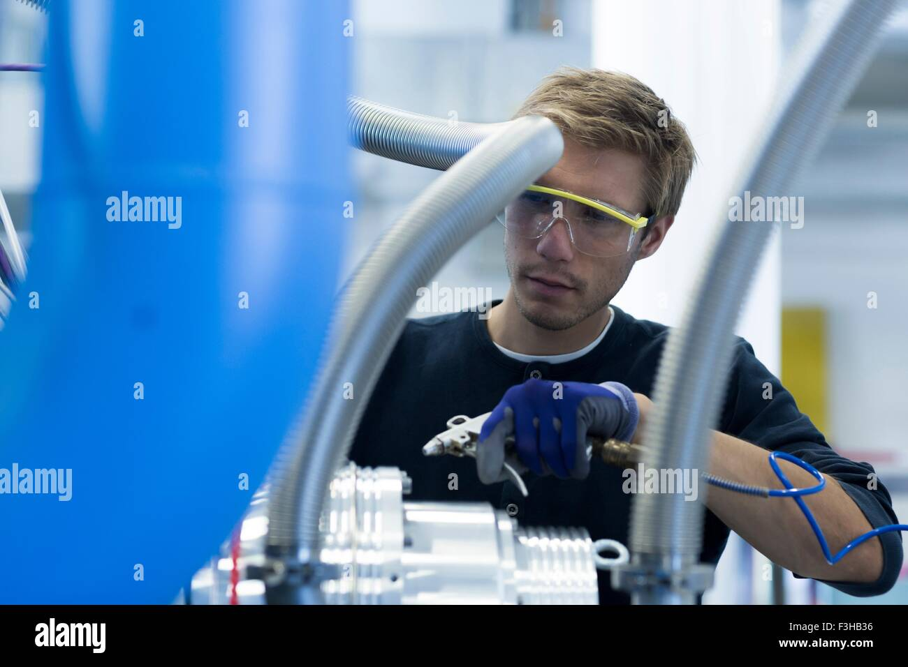 Factory technician maintaining network cables - Stock Image