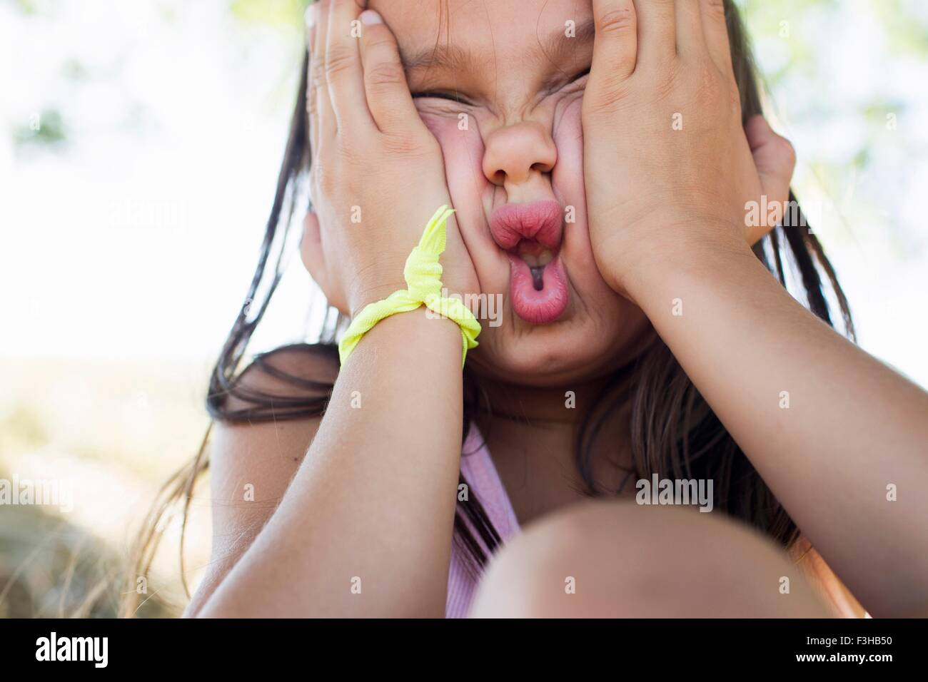 Portrait of girl squashing her face - Stock Image
