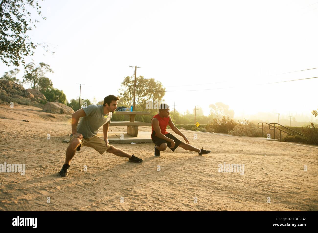 Two male friends working out together, outdoors Stock Photo