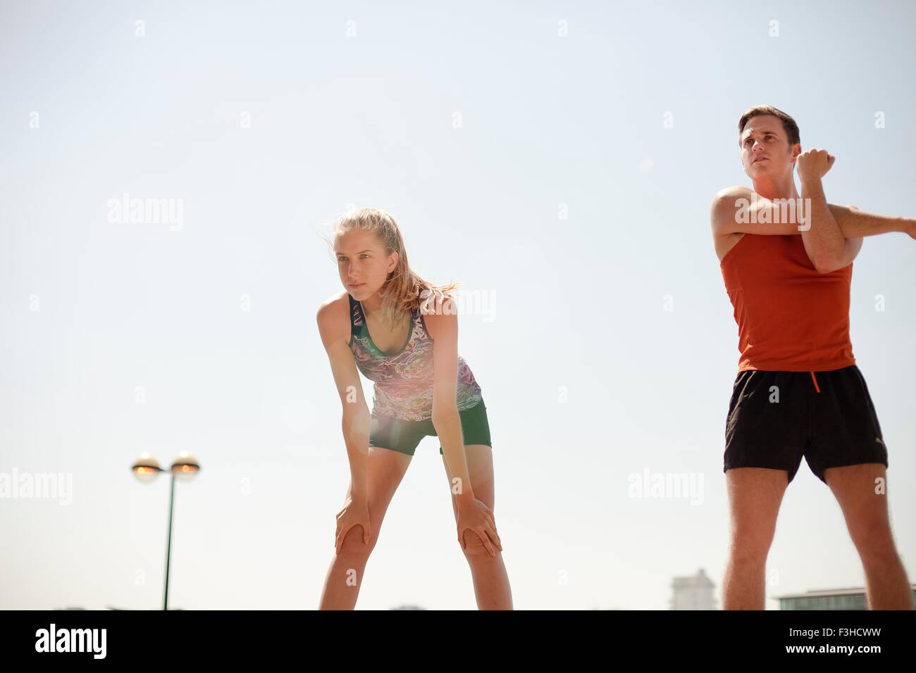Runners stretching during exercise - Stock Image