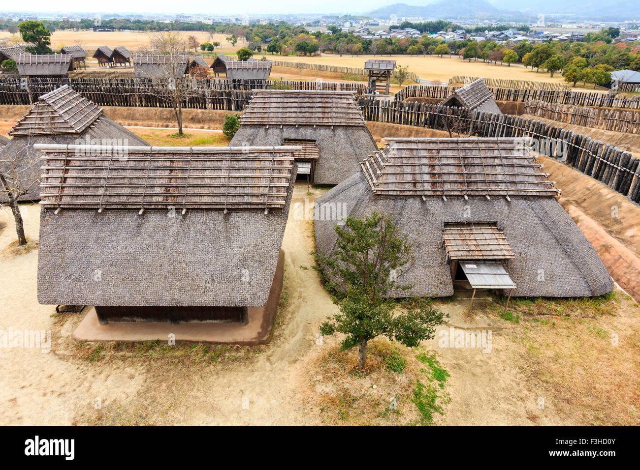 Yoshinogari Park. Yayoi settlement. Minaminaikaku rulers area. Houses and storehouses - Stock Image