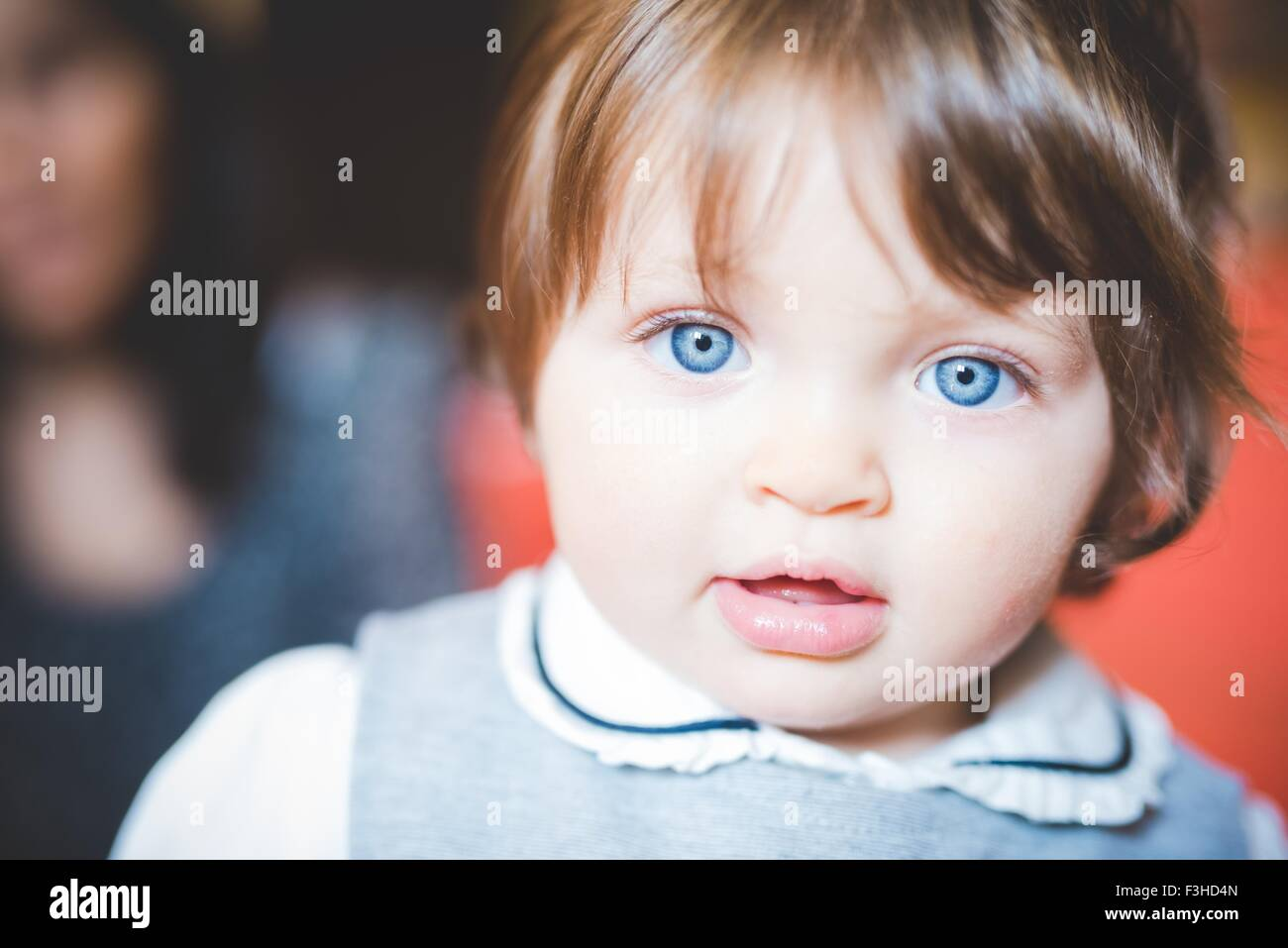 Close up portrait of female toddler with blue eyes - Stock Image