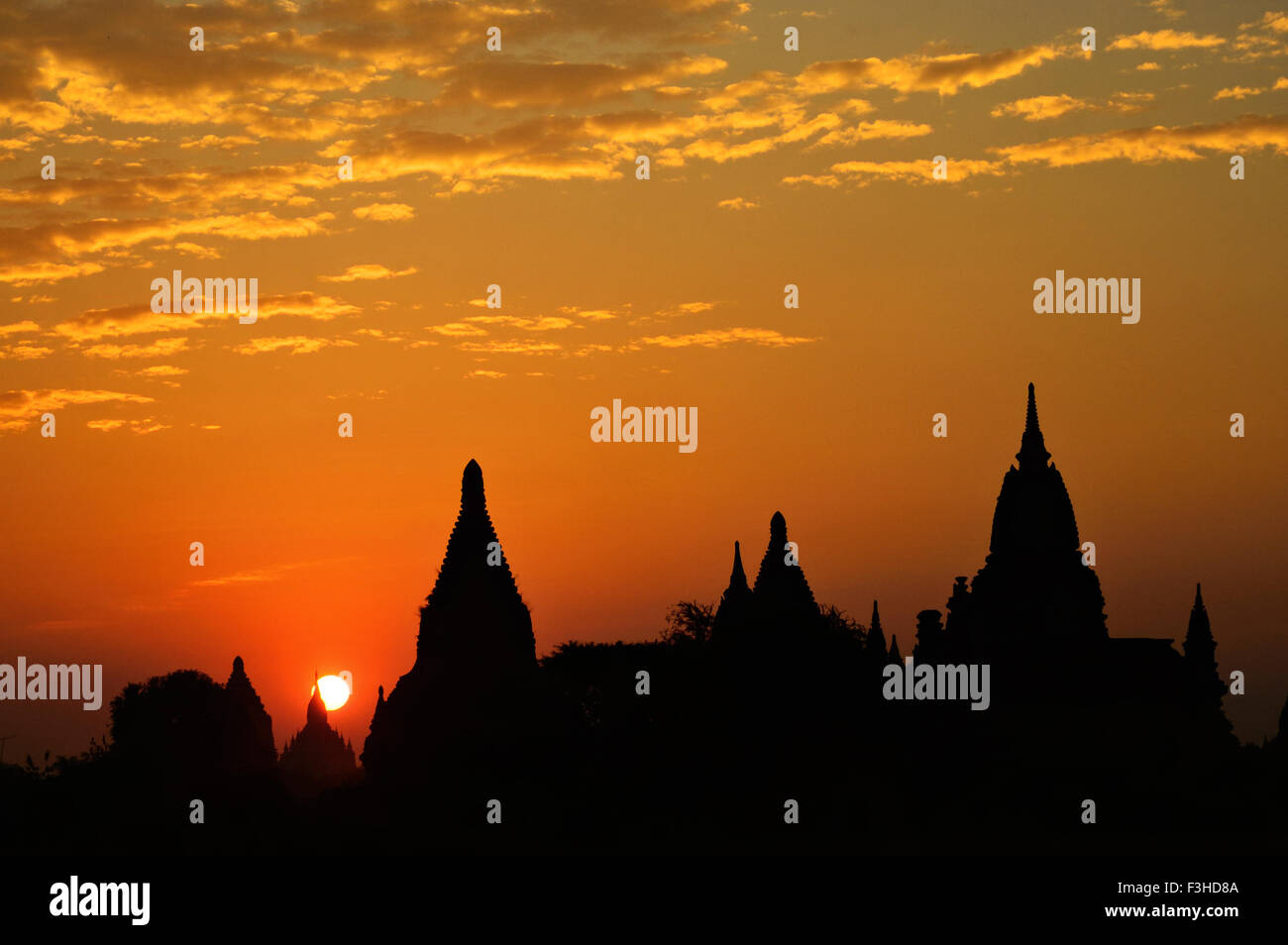 Silhouette of the buddhist temples in Bagan at sunrise, Mandalay Region, Myanmar - Stock Image
