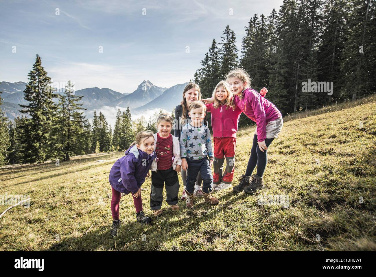 Portrait of two women and four children in field, Achenkirch, Austria - Stock Image